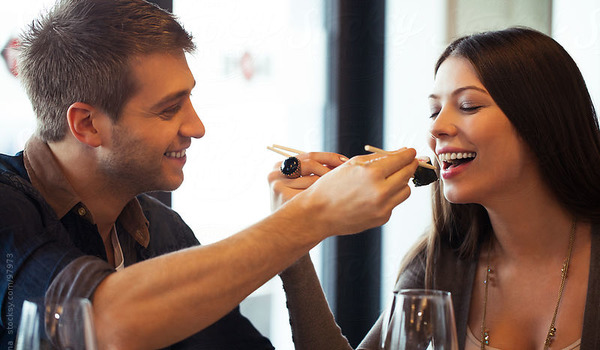 Couple Feeding Each Other at a Restaurant