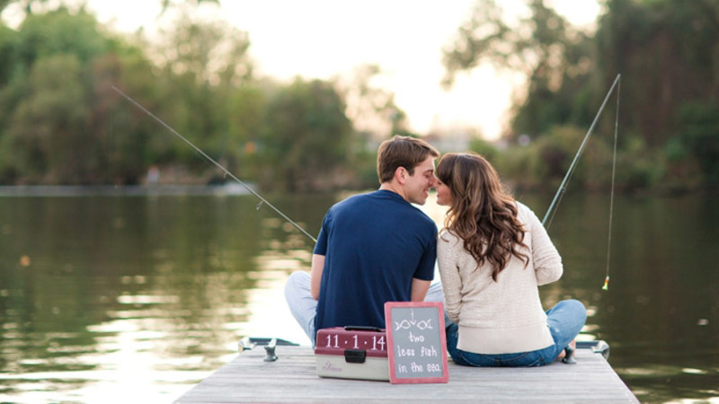 couple fishing together summer date