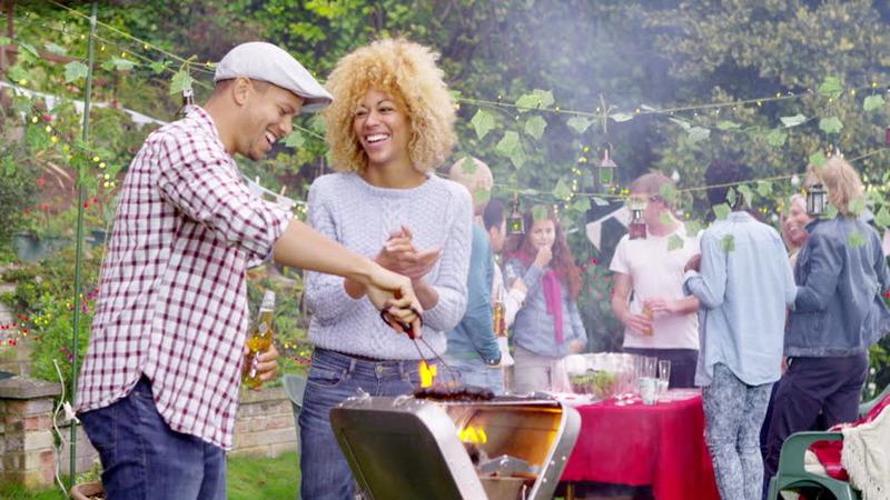 couple attending BBQ summer date